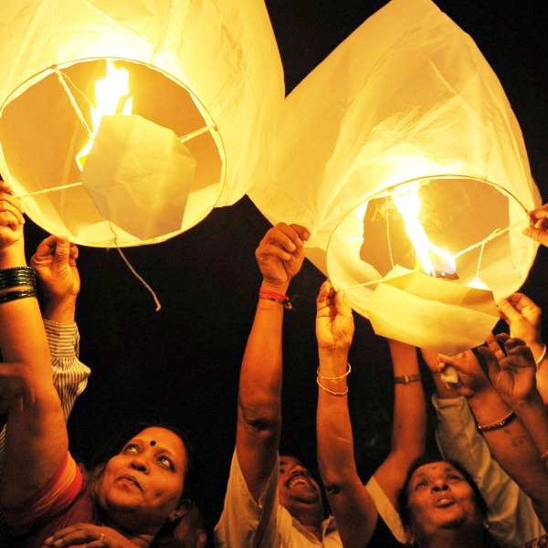 All India Peace and Solidarity Organisation (AIPSO) members launch sky lanterns during International Women's Day in Hyderabad on March 8, 2013. International Women's Day is marked on March 8 every year. AFP PHOTO / Noah SEELAM        (Photo credit should read NOAH SEELAM/AFP/Getty Images)