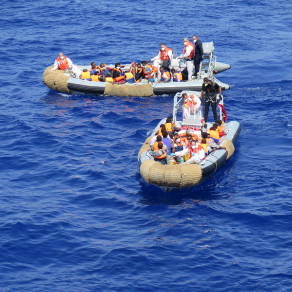 Italian Navy vessel Virginio Fasan, performing search and rescue activities in the Central Mediterranean as part of the Mare Nostrum operation, August 2014. The ship patrolled the central Mediterranean between the Italian island of Lampedusa, Tunisia and Libya. The Italian Navy vessel rescued 1,004 refugees and migrants on 14 August 2014. Using two rubber dinghies, a dozen people at a time were transferred to the Fasan. Families were transferred first. Some arrived barefoot, some children were shaking with cold. Men, women and children from Syria, Somalia, Gambia, Bangladesh and other countries were rescued. They were all disembarked in the port of Naples on 15 August 2014.
